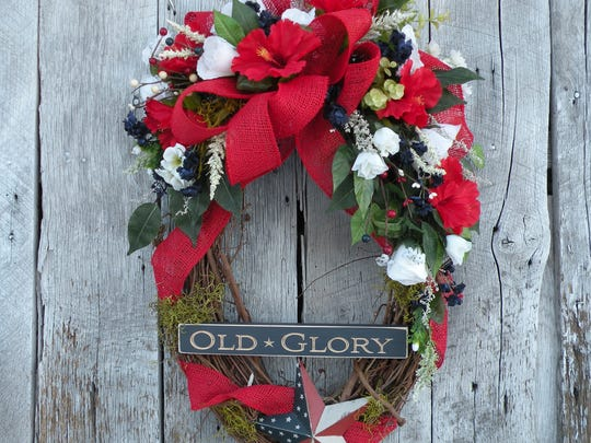 Kathy Baughman, of Newark, creates wreaths using flowers, moss and decorative items. She decided to turn her craft into a small business, Kathy's Wreath Shop, and launched an Etsy shop.