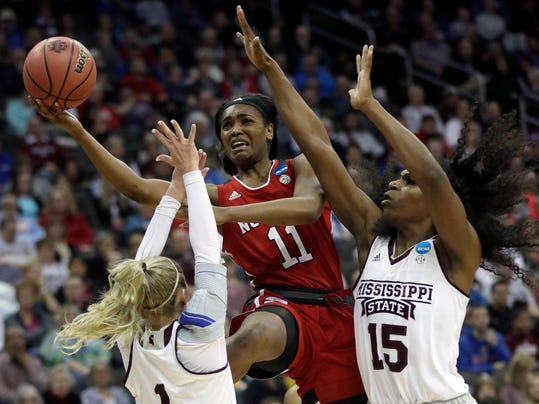 North Carolina State guard Kiara Leslie (11) shoots between Mississippi State guard Blair Schaefer (1) and center Teaira McCowan (15) during the first half of a women's NCAA college basketball tournament regional semifinal game, Friday, March 23, 2018, in Kansas City, Mo. (AP Photo/Orlin Wagner)