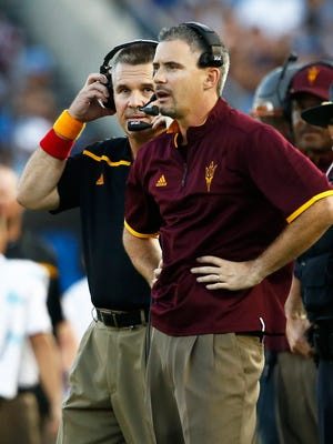 Arizona State offensive coordinator Mike Norvell (front) and head coach Todd Graham work the game against UCLA in the second quarter on Oct. 3, 2015, at the Rose Bowl in Pasadena, Calif.