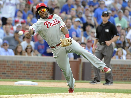 Phillies third baseman Maikel Franco makes a game-saving play on a bunt by Chicago Cubs' David Ross in the eighth inning Friday in Chicago.