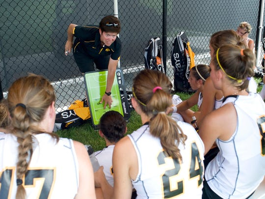 Iowa Hawkeyes women's field hockey coach Tracey Griesbaum works on a play with the team in this undated photo. The field hockey program under Griesbaum was one of the most successful in the Iowa athletic department. Griesbaum was fired in August over allegations of player mistreatment.