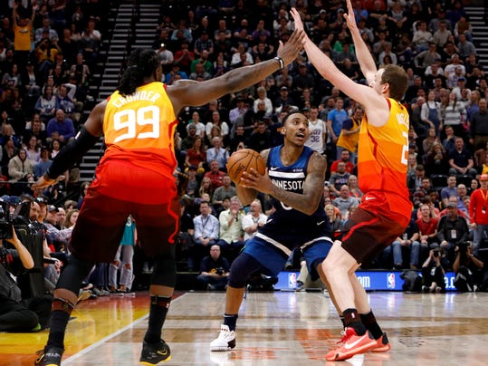 Utah Jazz's Jae Crowder (99) and Joe Ingles, right, defend as Minnesota Timberwolves' Jeff Teague, middle, looks to pass during the first half of an NBA basketball game Friday, March 2, 2018, in Salt Lake City. (AP Photo/Kim Raff)