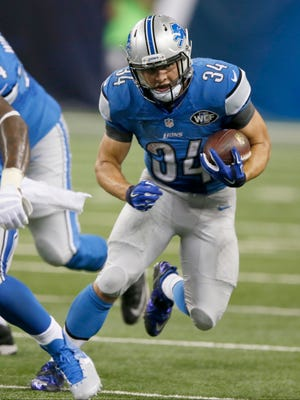 Detroit Lions running back Zach Zenner picks up a first down in the fourth quarter of a 23-3 win over the New York Jets on Thursday, Aug. 13, 2015, in Detroit.