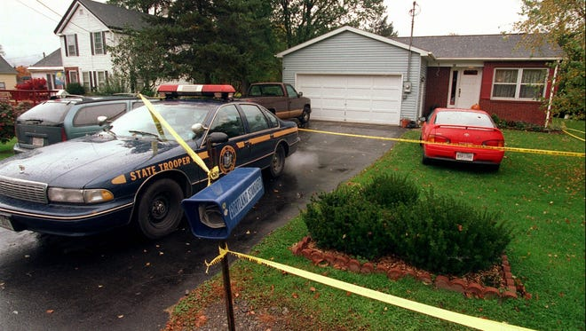 -  -Police tape surrounds the Hajney home, right, and the home of John Andrews, left, in McLean Thursday, Oct. 10, 1996. Andrews murdered Sarah Hajney, and her friend Jennifer Bolduc, early Monday morning, Oct. 7, 1996. (Staff Photo/Shawn Dowd)
