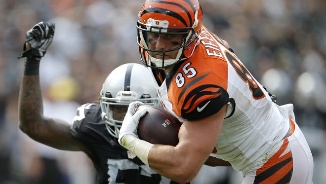 Cincinnati Bengals tight end Tyler Eifert (85) makes a catch over Oakland Raiders outside linebacker Ray-Ray Armstrong (57) in the second quarter during the NFL football game between the Cincinnati Bengals and Oakland Raiders, Sunday, Sept. 13, 2015, at O.co Coliseum, in Oakland, California.