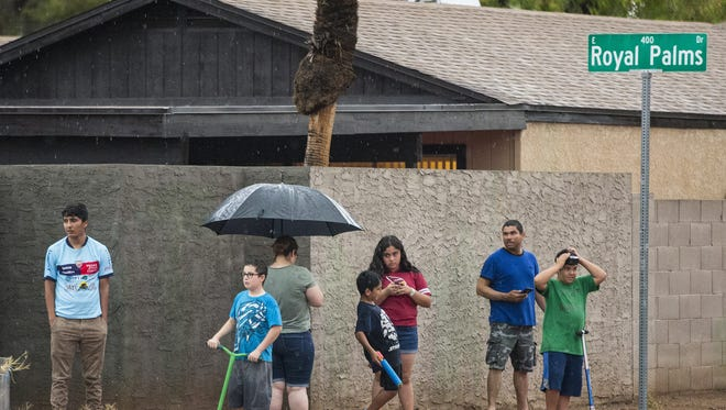 A monsoon hit the east Mesa flooding streets and downing power lines on July 9, 2018.