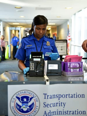 A transportation security officer checks IDs at a security checkpoint Thursday, Sept. 7, 2017, at Jackson-Medgar Wiley Evers International Airport.