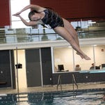 Coldwater High School diver Megan Hoath turns during a practice dive at the Dr. Robert W. Browne Aquatic Center on Sunday.