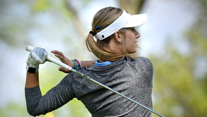 Cathedral's Lauren Herker takes a shot during competition Thursday, May 12, 2016, at the St. Cloud Country Club.
