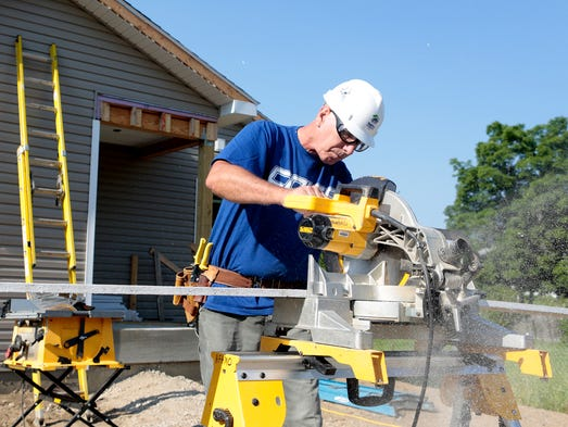 Mike Schroder, 63, works on a Habitat for Humanity build on Ridge Avenue in Newark. Since retiring, Schroder has kept busy volunteering around Licking County at various organizations.