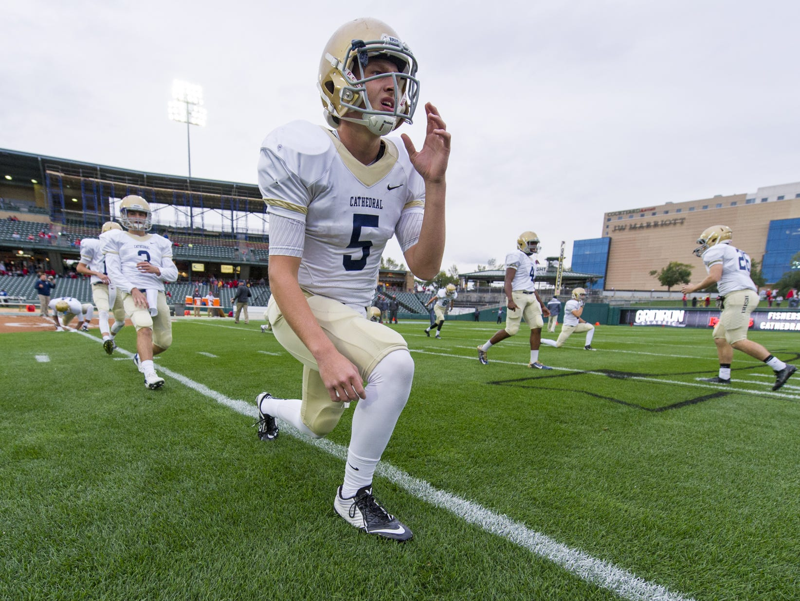 Cathedral QB Max Bortenschlager (5) warms up at Victory Field, Oct. 2, 2015. HSE and Brownsburg will play the second football game ever at the Indians' home on Friday.