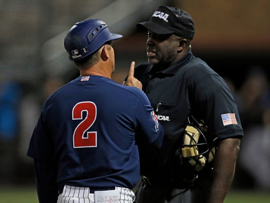 Arizona coach Jay Johnson argues a call with the home plate umpire during an NCAA college baseball tournament regional game against Sam Houston State, Friday, June 2, 2017, in Lubbock, Texas. (Brad Tollefson/Lubbock Avalanche-Journal via AP)