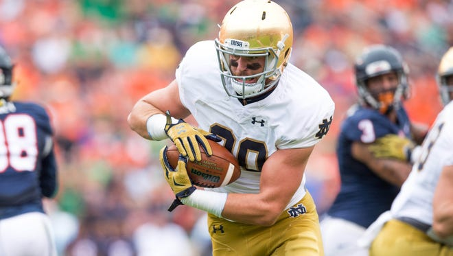 Sep 12, 2015; Charlottesville, VA, USA; Notre Dame Fighting Irish tight end Durham Smythe (80) runs for a touchdown on a fake field goal in the first quarter against the Virginia Cavaliers at Scott Stadium. Mandatory Credit: Matt Cashore-USA TODAY Sports