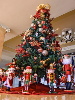 A Christmas tree decorated with a nutcracker theme can be found among other trees as part of the holiday decorations at the Government House in Agana Heights on Wednesday, Nov. 28, 2017.