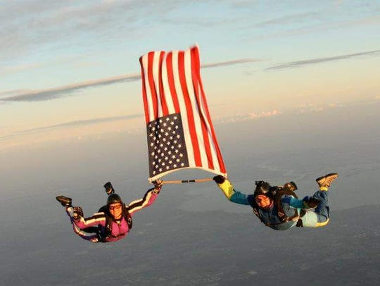 Skydivers Kristal Ciamillo and Ken Bernek in freefall