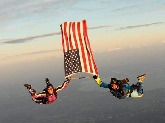Skydivers Kristal Ciamillo and Ken Bernek in freefall