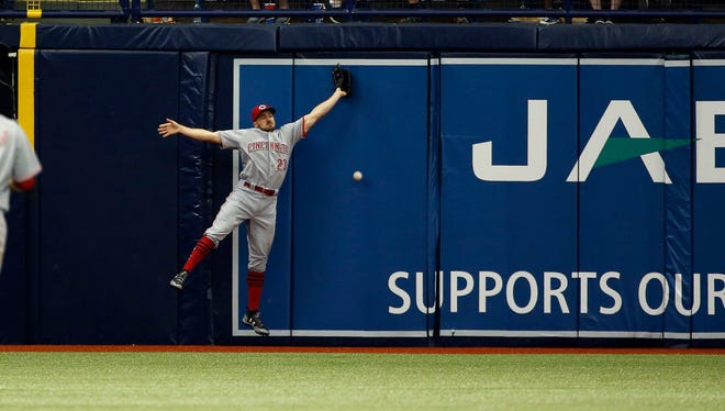 Cincinnati Reds left fielder Adam Duvall (23) misses a fly ball during the fifth inning against the Tampa Bay Rays at Tropicana Field.