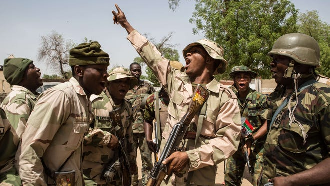 Nigerian troops celebrate after taking over Bama from Boko Haram on March 25, 2015.