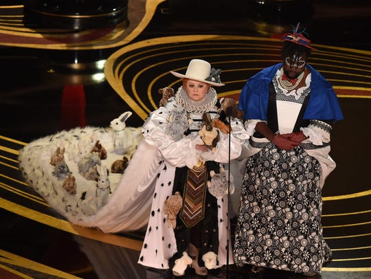 Melissa McCarthy and Brian Tyree Henry present an award
