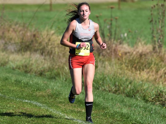 Sheridan's Anna Foster leads the way in the MVL girls race on Saturday. She won her second straight league title with a time of 19:24.