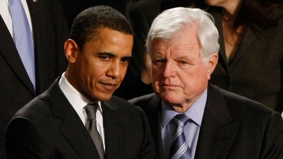 Sen. Barack Obama confers with Sen. Edward Kennedy