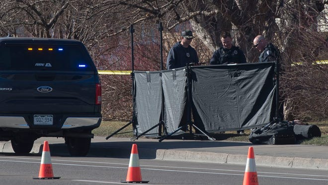 Police work the scene where a body was found on Tuesday, March 13, 2018, in front of the Heritage Park Apartments on Shields Street in Fort Collins, Colo.