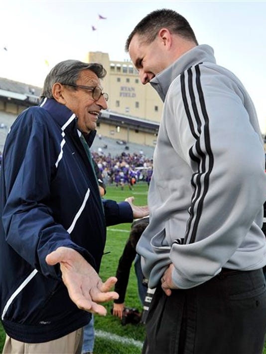 Penn State coach Joe Paterno, left, talks with Northwestern coach Pat Fitzgerald before Saturday's game. Paterno also met with Fitzgerald's children during halftime.
