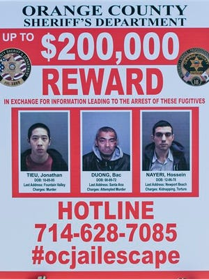 A wanted sign is displayed for the The reward for information leading to the arrest of the  the three escaped inmates from the Orange County Central Men's Jail on Tuesday, Jan. 26, 2016, in Santa Ana, Calif.  Hossein Nayeri, Jonathan Tieu and Bac Duong are believed to be dangerous and all were awaiting trial for separate violent felonies, authorities said. (Paul Rodriguez/The Orange County Register via AP)   MAGS OUT; LOS ANGELES TIMES OUT; MANDATORY CREDIT