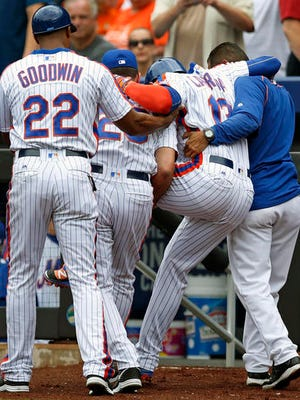 FILE - In this July 31, 2016, file photo, New York Mets Asdrubal Cabrera is carried off the field by coaches and a trainer after he limped across the plate during a baseball game against the Colorado Rockies, in New York. The rise in Major League Baseball's average salary slowed this year as more players got hurt and wound up on the disabled list, leaving the increase at just under $14,000.