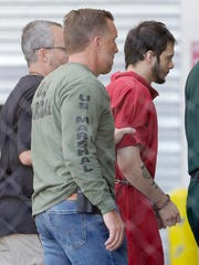 FILE- In this Jan. 9, 2017 file photo, Esteban Santiago, right, accused of fatally shooting several people and wounding multiple others at a crowded Florida airport baggage claim, is returned to Broward County's main jail after his first court appearance in Fort Lauderdale, Fla. Authorities say such walk-ins are a daily occurrence around the country. Assessing whether the people are reporting a credible threat or whether they need medical help is extremely difficult and drains already-stretched law enforcement resources.