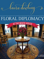 "This undated photo provided by Stichting Kunstboek shows the cover of the book ""Floral Diplomacy: At the White House,"" by Laura Dowling."