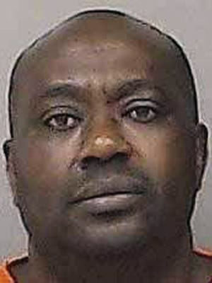 This an undated photo provided by the Linn County Jail in Cedar Rapids, Iowa, shows Gervais Ngombwa. A federal judge is expected to sentence Ngombwa, a Rwandan man Thursday, March 2, 2017, for lying to gain citizenship in the U.S. after helping carry out deadly attacks during the country's 1994 genocide.