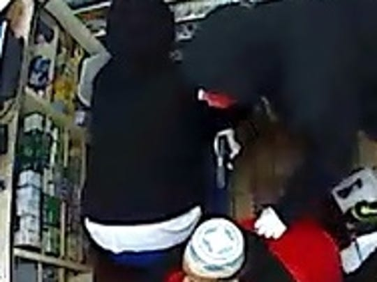 Surveillance video of 7-11 robbery in Cherry Hill.