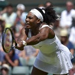 Serena Williams of U.S.A. plays a shot during her match against Margarita Gasparyan of Russia at the Wimbledon Tennis Championships in London, June 29, 2015. REUTERS/Toby Melville