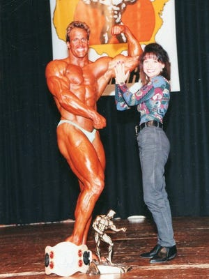 Peter LaReau poses for photos after a bodybuilding competition decades ago with his wife, Lisa LaReau, by his side.