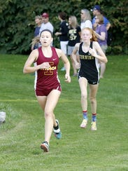 Ithaca's Lizzy Rayle leads Corning's Claire Mason on