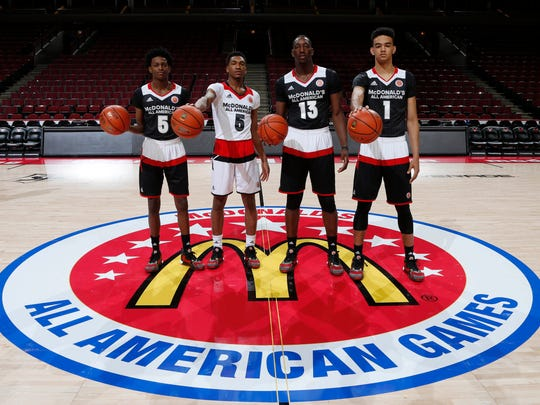 Mar 30, 2016; Chicago, IL, USA; From left to right McDonald's All-Americans De'Aaron Fox (5), Malik Monk (5) Bam Adebayo (13), and Sacha Killeya-Jones (1) who will all be attending the University of Kentucky pose for a group photo before the McDonald's High School All-American Game at the United Center. Mandatory Credit: Brian Spurlock-USA TODAY Sports