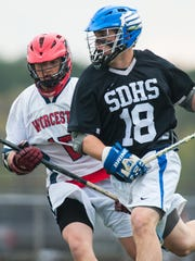 Corey Gwin (18) played his high school ball at nearby Stephen Decatur. Here, in a 2015 game, he works against Worcester Prep defender Max Bisaha (17).