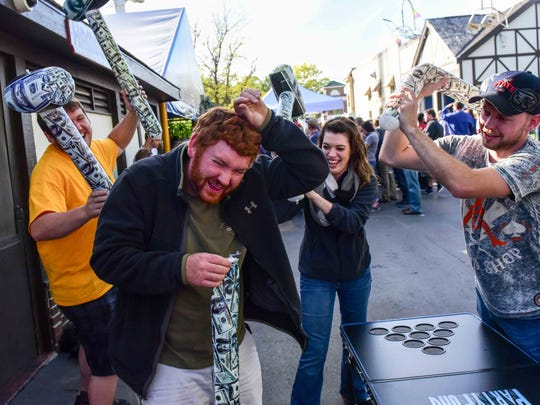 Merle Laswell/For the Register South side resident Jason Borrall pays the price after loosing at beer pong on Oct. 3 during Oktoberfest at Adventureland. Southsider Jason Borrall pays the price after loosing at beer pong on Saturday, October 3, 2015, during Oktoberfest at Adventureland.