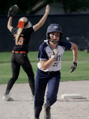 Macomb Dakota's Melissa Charbonneau sprints to third base during Dakota's 9-1 win over Utica Tuesday at Sterling Heights Stevenson.