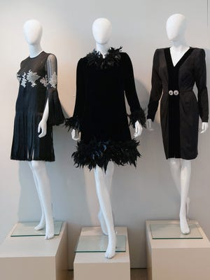 """A set of dresses from the 1970s from designers James Galanos (from left), Geoffrey Beene and Hubert de Givenchy. From the exhibit """"Little Black Dress: Through the Decades"""""""