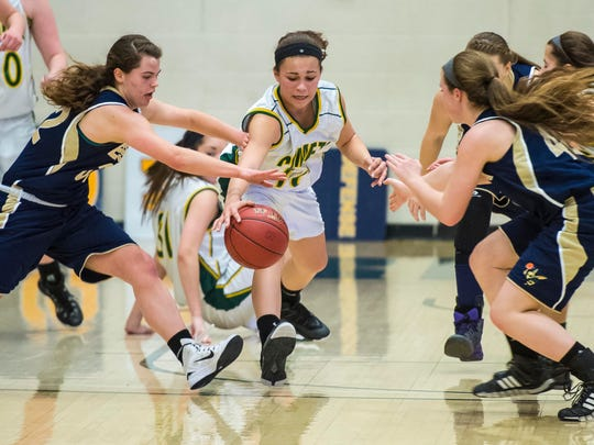 Essex's Mychaela Harton (left) and BFA's Hannah Earl chase down the ball during the D-1 girls semifinal at Patrick Gymnasium in Burlington on Thursday, March 5, 2015.
