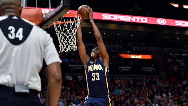 Indiana Pacers center Myles Turner (33) dunks the ball against the Miami Heat guard Dion Waiters (11) during the first half at American Airlines Arena.