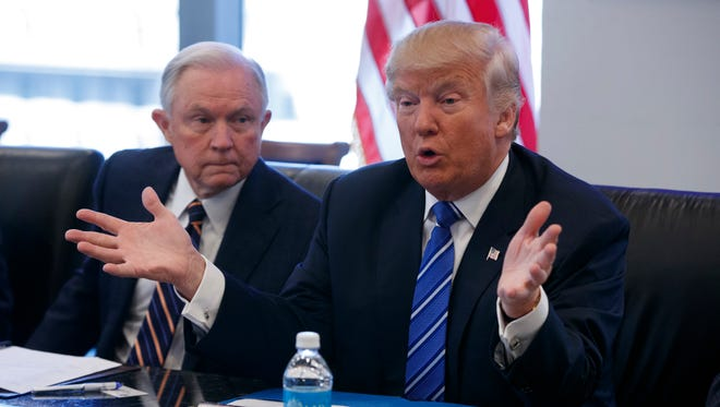 Sen. Jeff Sessions, R-Ala., with President-elect Donald Trump during a meeting at Trump Tower
