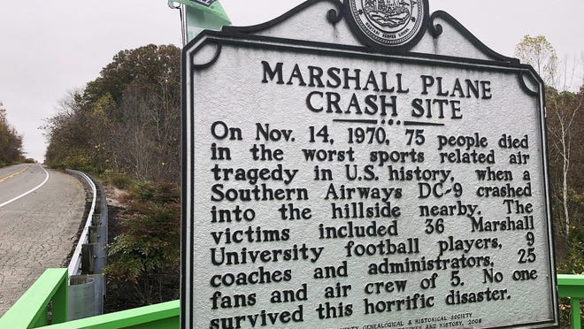 A memorial plaque is displayed at the site of a 1970 plane crash that killed 75 people, including 36 Marshall football players, near Huntington, W.Va. The Nov. 14, 1970 crash remains the worst sports disaster in U.S. history.