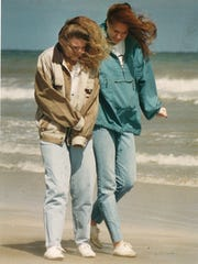 University of Notre Dame students Julie Gahm (left) and Stephanie Dattilo didn't let the cold weather keep them from taking a stroll on Mustang Island March 10, 1994. They wore jackets and had the whole beach to themselves.