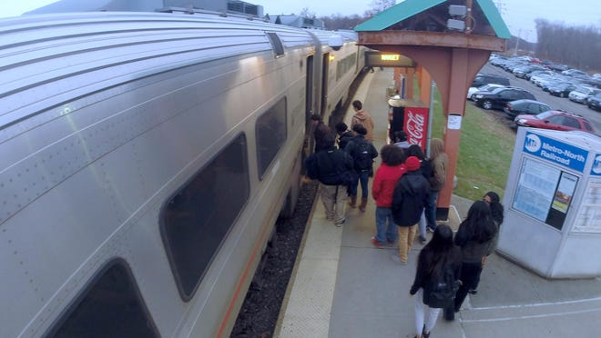 Passengers board a New Jersey Transit train at the Nanuet station Dec. 5, 2014. Passengers in Rockland and Orange counties could possibly travel directly into Manhattan if a connecting loop is constructed as part of the proposed Gateway tunnels project.