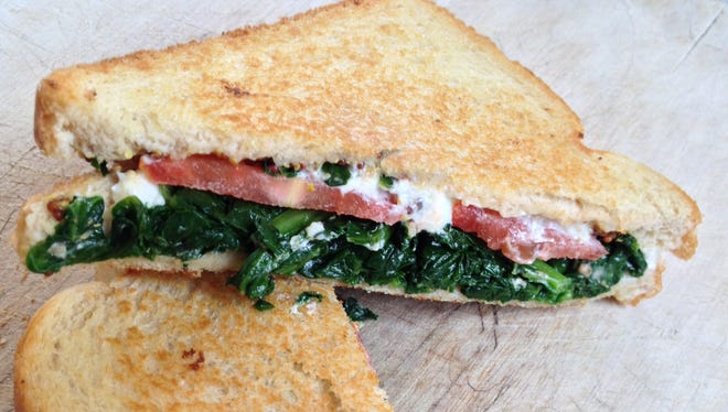 Spinach and goat cheese grilled sandwich with tomato.