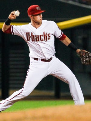 Arizona Diamondbacks third baseman Jake Lamb throws to second base after fielding a ground ball in the first inning at Chase Field on Tuesday, Aug. 11, 2015, in Phoenix.