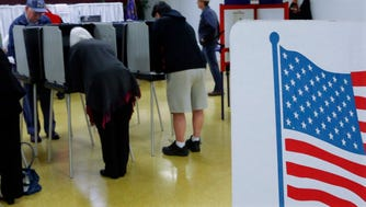 Area residents cast their ballots for the midterm elections Tuesday, Nov. 4, 2014, in Springfield, Ill.